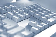 Het toetsenbord knoopt blauwe toon dicht Stock Fotografie