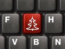 Het toetsenbord van de computer met de sleutel van de Kerstboom Stock Foto's
