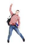 Het toevallige jonge mens springen stock afbeelding