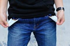 Het tonen heeft geen geld door de zakken te blijken Stock Afbeelding