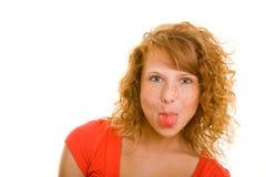 Het tonen van de tong Stock Afbeeldingen