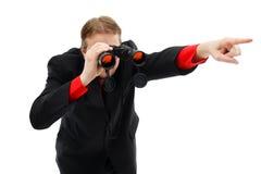 Het tonen van richting met verrekijkers Stock Foto's