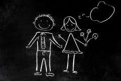 Het trekken met krijt op zwart jongen en meisje als achtergrond Stock Foto