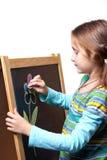 Het trekken op een houten schildersezel Stock Afbeelding