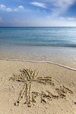 Het trekken op zand wordt het ook geschreven palm Royalty-vrije Stock Foto's