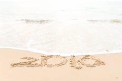 Het trekken van 2016 op het strand Stock Fotografie