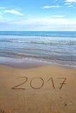 Het trekken van 2017 op het zand Stock Foto's