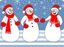 Het trio van sneeuwmannen Stock Foto