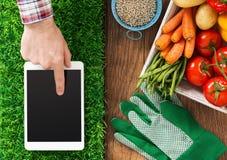 Het tuinieren app Stock Foto's