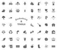 Het tuinieren en van de hulpmiddelentekst brievenpictogram Het tuinieren en geplaatste hulpmiddelen vectorpictogrammen Stock Afbeeldingen