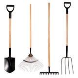 Het tuinieren hulpmiddelen, spade, vork en hark royalty-vrije stock foto's