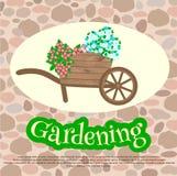 Het tuinieren Tuinkruiwagen met bloemen Stock Afbeelding