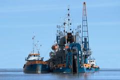 Het uitbaggeren van schip op het werk Royalty-vrije Stock Foto