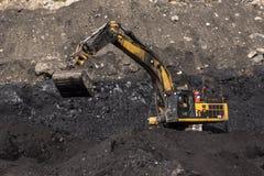 Het uitgraven van de steenkool stock foto