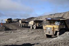 Het uitgraven van de steenkool stock afbeeldingen