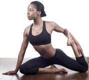 Het uitrekken zich van de yoga stock fotografie