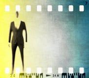 Het uitstekende kader van de filmstrook met gestileerd mannelijk cijfer Stock Foto's