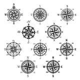 Het uitstekende kompas en de wind namen geïsoleerde symboolreeks toe royalty-vrije illustratie