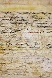 Het Untranslatable schrijven op oud perkament Stock Fotografie