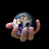 Het is in uw handen? Het houden van de aarde stock afbeelding