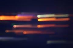 Het vage beeld van kleurrijk defocused bokeh Lichten motie en nachtlevenconcept Royalty-vrije Stock Afbeeldingen