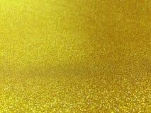 Het vage gouden beeld bokeh licht glanst want vrolijke Kerstmis schittert achtergrond viert, mooi schitter gouden gloed bokeh fon stock foto