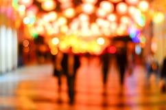 Het vage stad winkelen en mensen stedelijke scène Stock Afbeeldingen