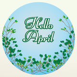Het van letters voorzien van Hello April op blauwe achtergrond met boomtakken Stock Foto