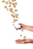 Het vangen van dalende dollars en centen Stock Fotografie