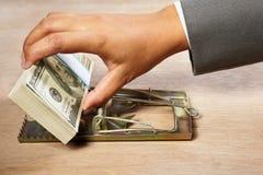 Het vangen van geld stock foto's