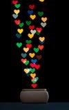 Het vangen van harten in een doos stock afbeelding