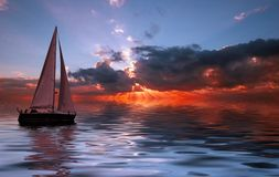Het varen bij zonsondergang Stock Afbeelding