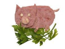 Het varken, dat van de stukken van een ham wordt gemaakt stock afbeeldingen