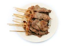 Het Varkensvlees van het braadstuk in een Stok Royalty-vrije Stock Afbeeldingen