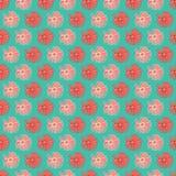 Het vectorrood en perzik kleurrijke madeliefje bloeit naadloos patroon met een groene achtergrond vector illustratie