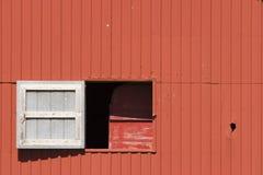 Het venster van de schommeling op schuur Stock Afbeeldingen
