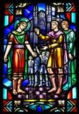 Het Venster van het Gebrandschilderd glas van de kerk met Godsdienstige Scène Stock Afbeeldingen