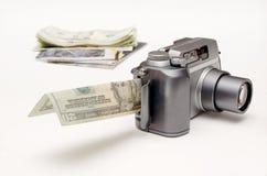 Het veranderen van foto's in geld stock afbeelding