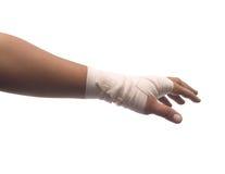 Het verband van de geneeskunde op menselijke hand Stock Foto