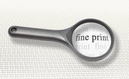 Het vergrootglas van kleine lettertjes Royalty-vrije Stock Afbeeldingen