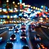 Het verkeer van de avond. De stadslichten. royalty-vrije stock foto