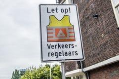 Het Verkeersverdedigers van het aanplakbordhorloge uit aan het Werk bij het Nederland van Amsterdam stock afbeeldingen