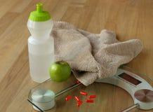 Het verlies van het gewicht door dieetpillen Stock Foto