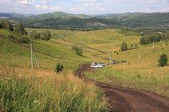 Het verminderen van een berg. Stock Foto