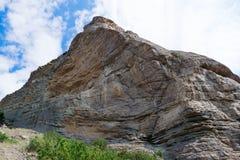 Het vernietigen van een stuk van de rots Stock Afbeelding