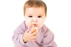 Het verraste baby eten stock afbeelding