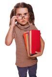 Het verraste bang gemaakte tienermeisje, verwarde kind met boekenschool stock afbeeldingen