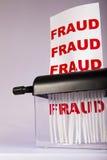 Het verscheuren van fraude. stock afbeelding