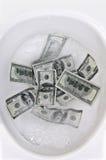 Het verspillen van geld Stock Foto's