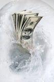 Het verspillen van geld Stock Foto